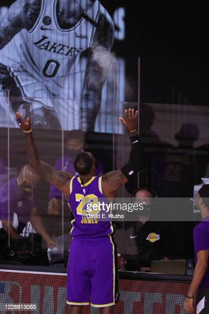 Playoffs: Rear view of Los Angeles Lakers LeBron James tossing talc powder in air before game vs Denver Nuggets at AdventHealth Arena. Orlando, FL...