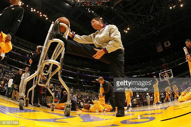 Basketball: NBA Playoffs, Referee Tim Donaghy stretching during warmups before Game 3 of Phoenix Suns vs Los Angeles Lakers series, Los Angeles, CA...