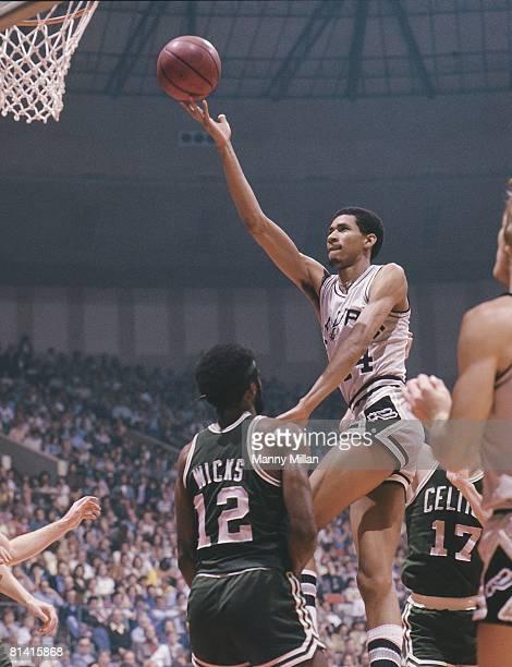 Basketball NBA Playoffs San Antonio Spurs George Gervin in action layup vs Boston Celtics Sidney Wicks Game 2 San Antonio TX 4/15/1977