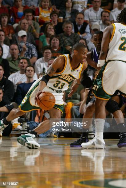 Basketball NBA playoffs Seattle SuperSonics Antonio Daniels in action during pick by teammate Danny Fortson vs Sacramento Kings Cuttino Mobley...