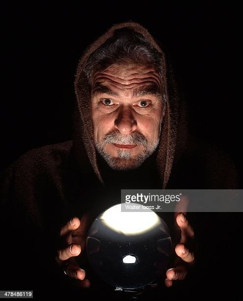 NBA Season Preview Closeup unusual portrait of Los Angeles Lakers coach Phil Jackson wearing robe and looking into crystal ball during photo shoot...