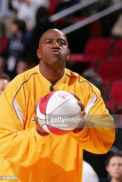 Basketball NBA Shooting Stars Contest Closeup of former Los Angeles Lakers player Magic Johnson in action during competition Houston TX 2/18/2006