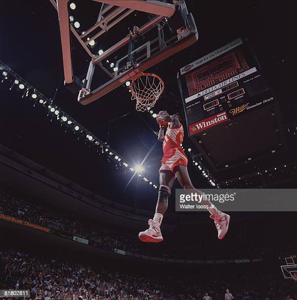 Basketball: NBA Slam Dunk Contest, Atlanta Hawks Dominique Wilkins in action, making dunk during All Star Weekend, Chicago, IL 2/6/1988