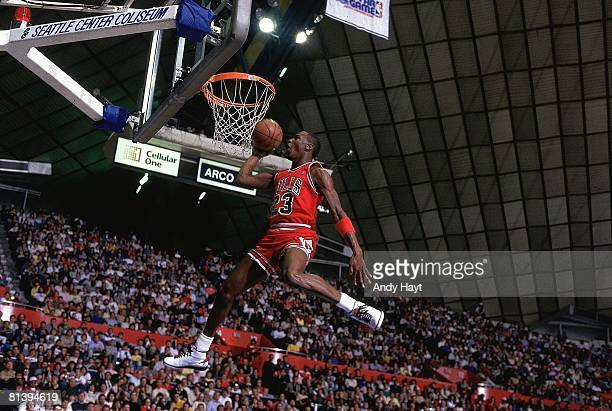 Basketball: NBA Slam Dunk Contest, Chicago Bulls Michael Jordan in action, making dunk during All Star Weekend, Seattle, WA 2/8/1987