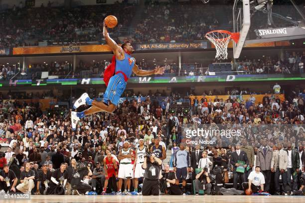 Basketball NBA Slam Dunk Contest Orlando Magic Dwight Howard in action making dunk and wearing Superman cape during All Star Weekend New Orleans LA...