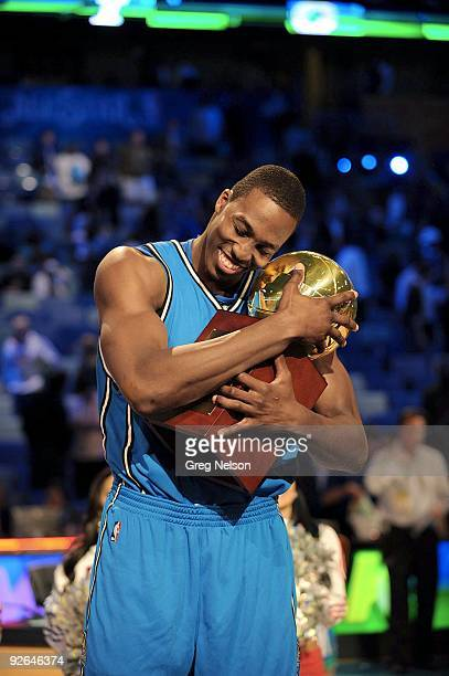 NBA Slam Dunk Contest Orlando Magic Dwight Howard victorious with trophy after winning competition during All Star Weekend New Orleans LA 2/16/2008...