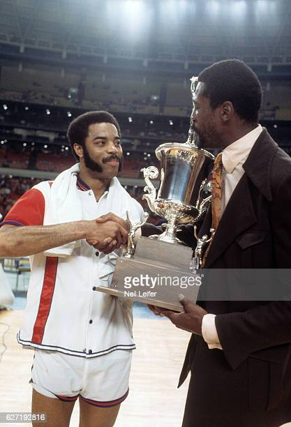 NBA/ABA All Star Game Boston Celtics coach Bill Russell victorious shaking hands with New York Knicks Walt Frazier after winning game vs ABA All...