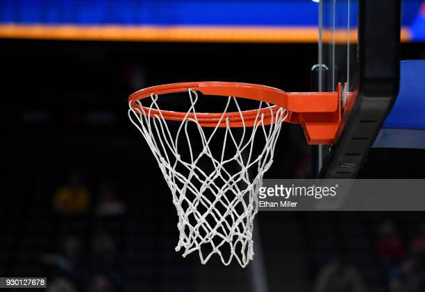 A basketball net and hoop are shown before a semifinal game of the Pac12 basketball tournament between the UCLA Bruins and the Arizona Wildcats at...