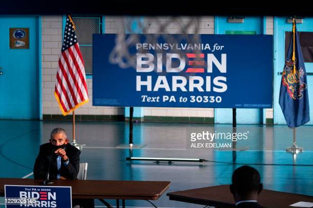 Basketball net hangs above as former US President Barack Obama speaks with supporters of Democratic presidential candidate Joe Biden and running mate...