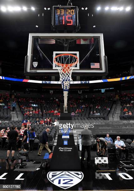 A basketball net hoop backboard and shot clock are shown before a semifinal game of the Pac12 basketball tournament between the UCLA Bruins and the...
