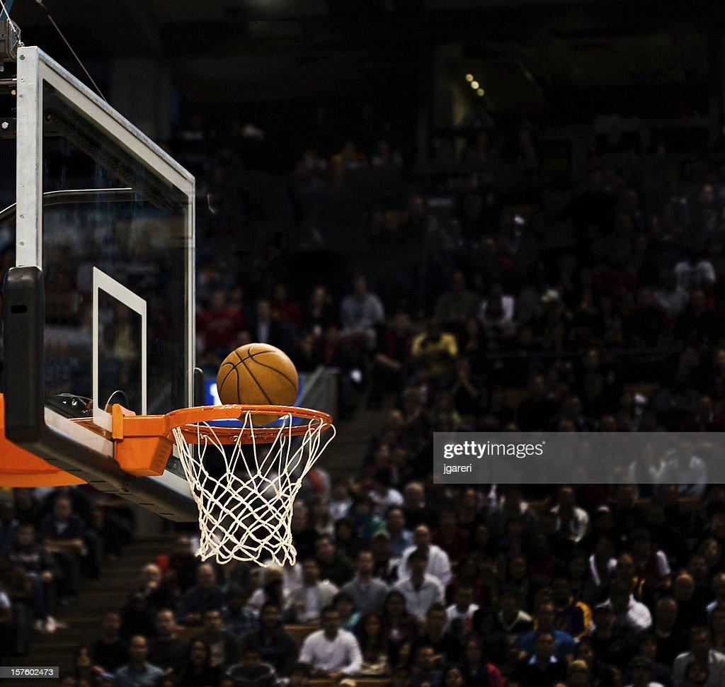 Basketball net with basketball near hoop : Stock Photo