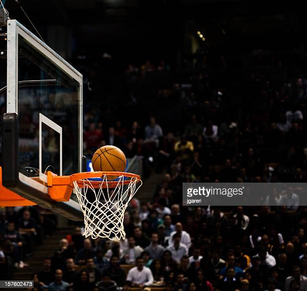 basketball net with basketball near hoop - basketball stadium stock pictures, royalty-free photos & images
