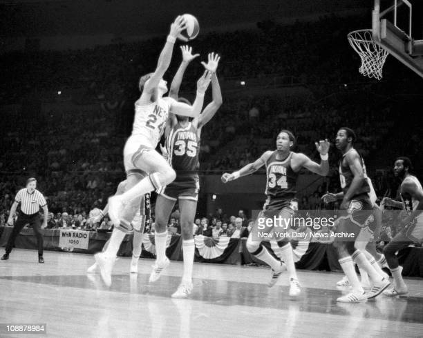 Basketball Nets vs Indiana Rick Barry shoots over Pacers' Roger Brown Mel Daniels and George McGinnis for two points while Nets' Trooper Washington...