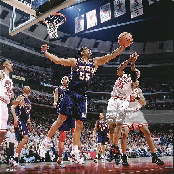 Basketball New Jersey Nets Jayson Williams in action vs Chicago Bulls Dennis Rodman Chicago IL 4/24/1998