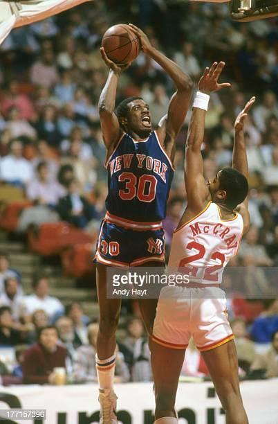 New York Knicks Bernard King in action shot vs Houston Rockets Rodney McCray at The SummitHouston TX 2/4/1984CREDIT Andy Hayt