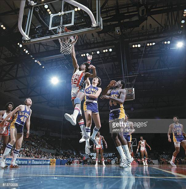 New York Nets Julius Dr J Erving in action vs Denver Nuggets Dave Robisch Uniondale NY 12/3/1973