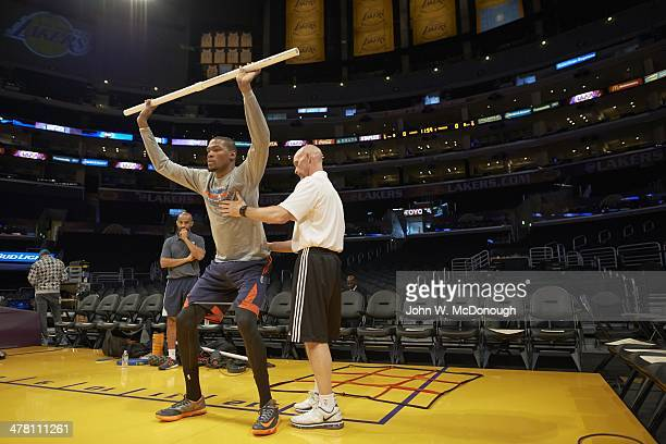 Oklahoma City Thunder Kevin Durant working with strength and conditioning coach Dwight Daub on court before game vs Los Angeles Lakers at Staples...