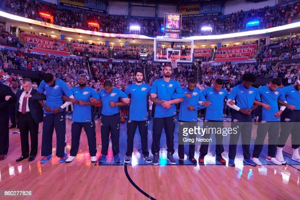 Oklahoma City Thunder players locking arms during anthem before preseason game vs New Orleans Pelicans at Chesapeake Energy Arena. Oklahoma City, OK...
