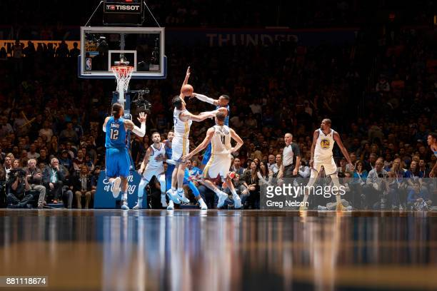 Oklahoma City Thunder Russell Westbrook in action passing vs Golden State Warriors Zaza Pachulia at Chesapeake Energy Arena Oklahoma City OK CREDIT...