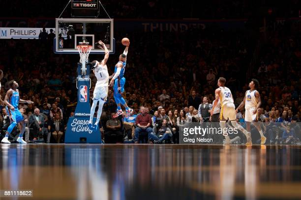 Oklahoma City Thunder Russell Westbrook in action vs Golden State Warriors JaVale McGee at Chesapeake Energy Arena Oklahoma City OK CREDIT Greg Nelson