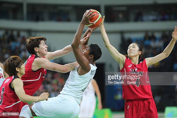 Basketball - Olympics: Day 11 Angel Mccoughtry of United States rebounds while defended by Ramu Tokashiki of Japan and Kaede Kondo of Japan during...