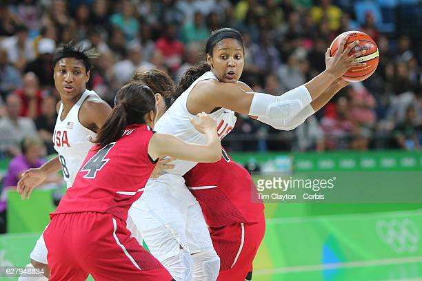 Basketball - Olympics: Day 11 Maya Moore of United States guarded by Kaede Kondo of Japan during the USA Vs Japan Women's Basketball Quarterfinal at...