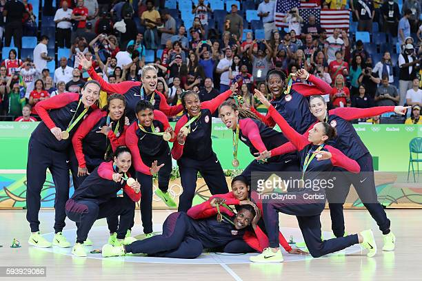 Day 15 The USA Women's Basketball Team at the medal presentation after winning gold during the USA Vs Spain Women's Basketball Final at Carioca...