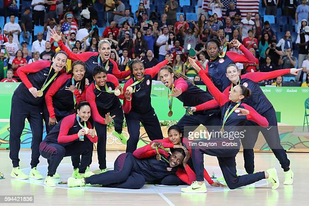 Basketball - Olympics: Day 15 Unites States players strike a pose after receiving their gold medals, players include, Lindsay Whalen, Seimone...