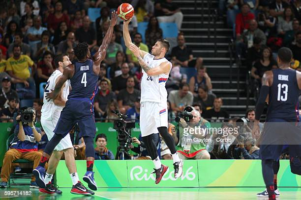 Day 16 Stefan Jovic of Serbia has his shot blocked by Jimmy Butler of United States during the USA Vs Serbia Men's Basketball Gold Medal game at...