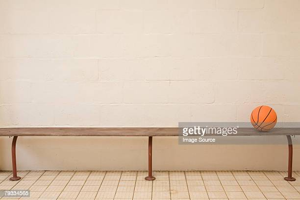 a basketball on a bench - locker room stock pictures, royalty-free photos & images