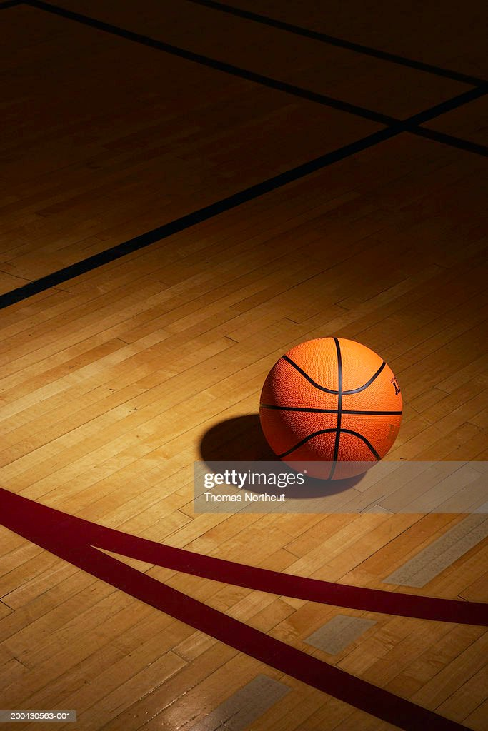 Basketball on basketball court, elevated view : Stock Photo