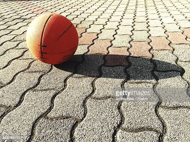 Basketball On Footpath During Sunny Day