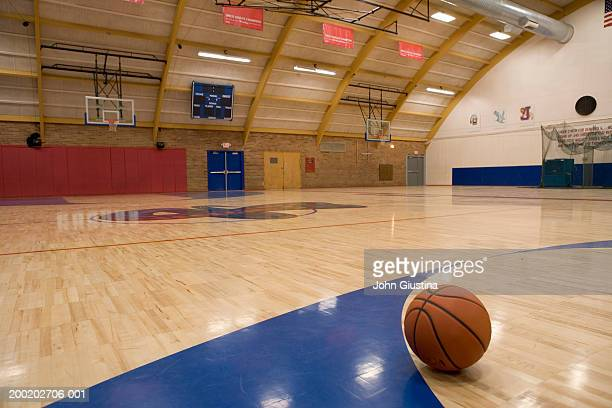 basketball on gym floor - sports court stock pictures, royalty-free photos & images