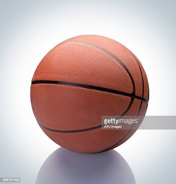 basketball on reflection - basketball stock-fotos und bilder