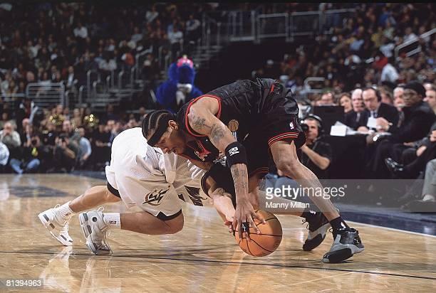 Basketball Philadelphia 76ers Allen Iverson in action getting loose ball vs Washington Wizards Tyronn Lue Washington DC 1/22/2002