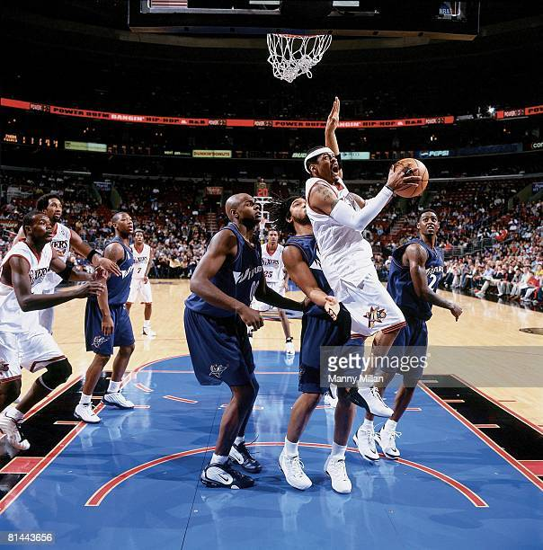 Basketball Philadelphia 76ers Allen Iverson in action vs Washington Wizards Etan Thomas and Brendan Haywood during preseason Philadelphia PA