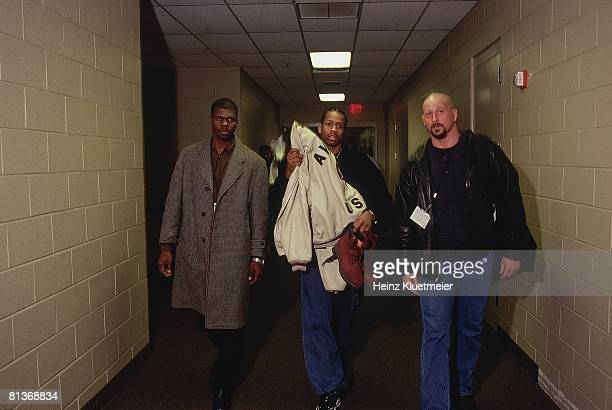 Basketball Philadelphia 76ers Allen Iverson with bodyguards after game Philadelphia PA 1/14/1998
