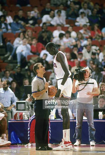 Philadelphia 76ers Manute Bol looking down at referee during game vs Washington Bullets at The SpectrumPhiladelphia PA CREDIT Damian Strohmeyer