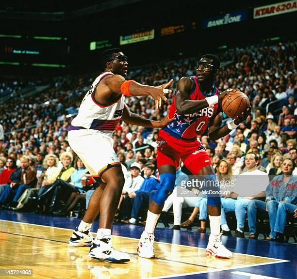 Philadelphia 76ers Orlando Woolridge in action vs Phoenix Suns Oliver Miller at America West Arena Phoenix AZ CREDIT John W McDonough