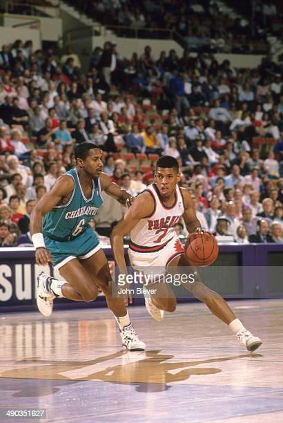 Phoenix Suns Kevin Johnson in action vs Charlotte Hornets Mike Holton at Arizona Veterans Memorial Coliseum Phoenix AZ CREDIT John Biever