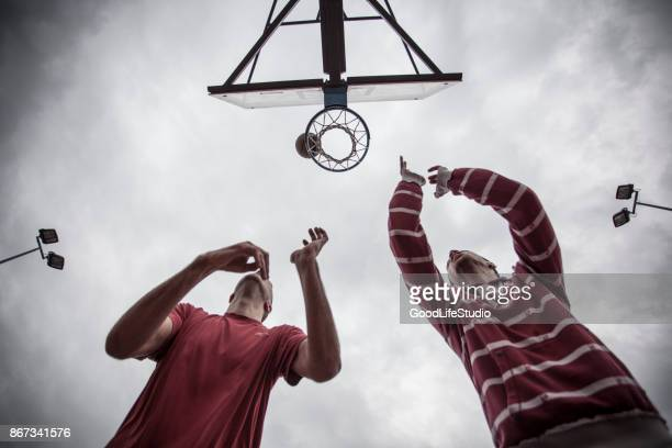 basketball - shooting baskets stock photos and pictures