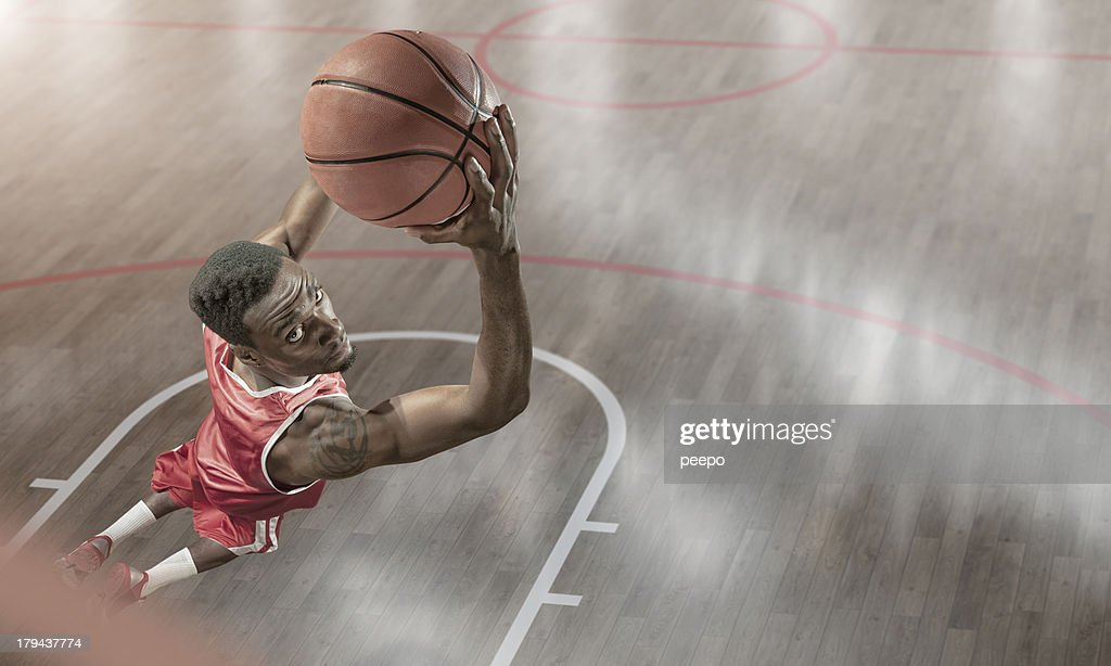 Basketball Player About to Reverse Dunk : Stock Photo
