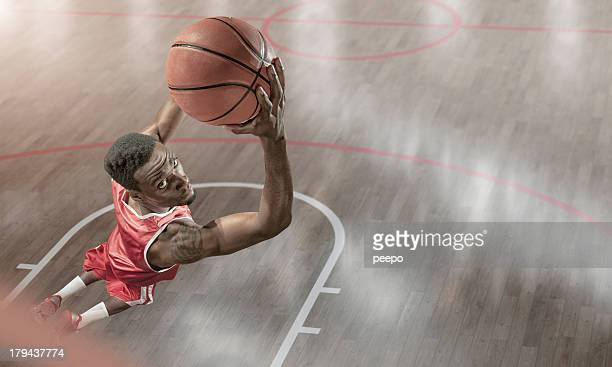 Basketball Player About to Reverse Dunk
