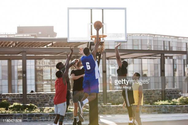 Basketball player about to score a hoop