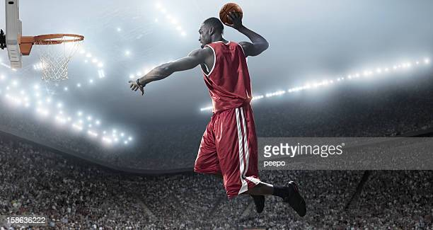 basketball player about to slam dunk - basketball player stock pictures, royalty-free photos & images