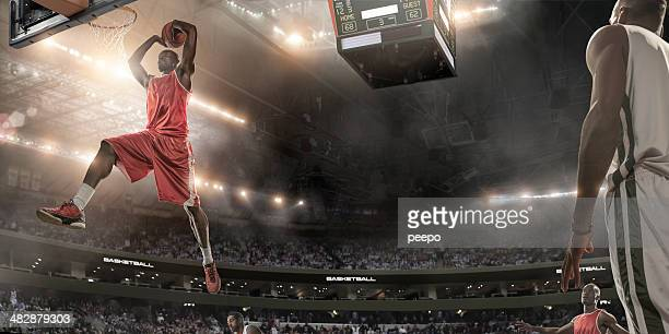 basketball player about to slam dunk - scoring a goal stock pictures, royalty-free photos & images