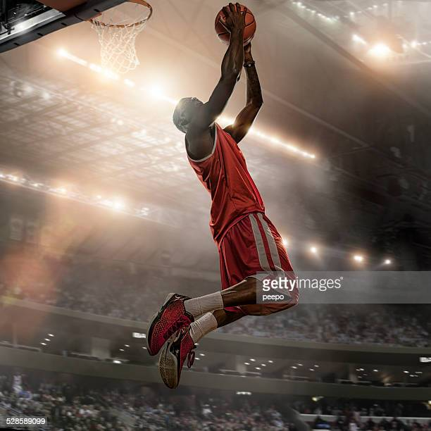 basketball player action - slam dunk stock pictures, royalty-free photos & images