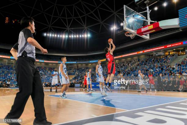 basketball player aiming ball for hoop - nba stock pictures, royalty-free photos & images