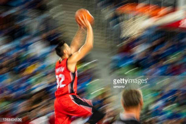 basketball player aiming ball for hoop - aiming stock pictures, royalty-free photos & images