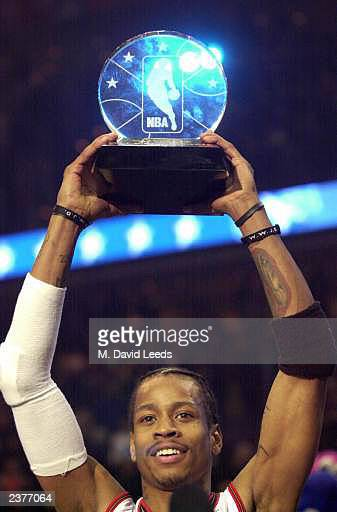 Basketball player Allen Iverson #3 of the Philadelphia 76ers and the Eastern Conference AllStars holds aloft his MVP trophy following the NBA AllStar...